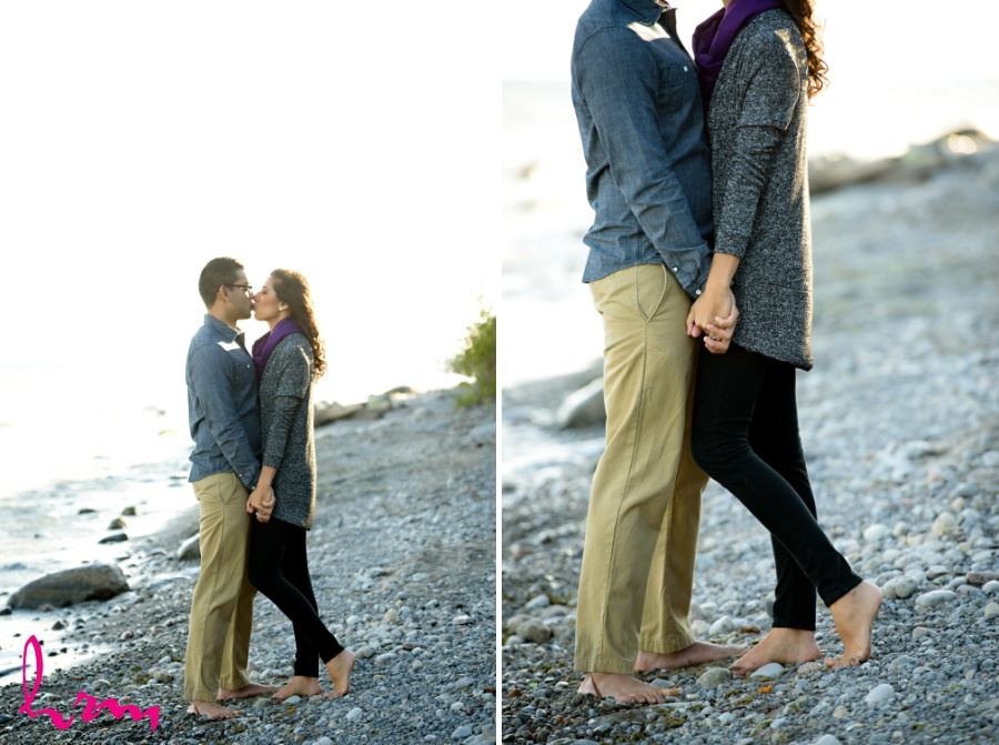 engagement session photography couple kissing on rocky beach