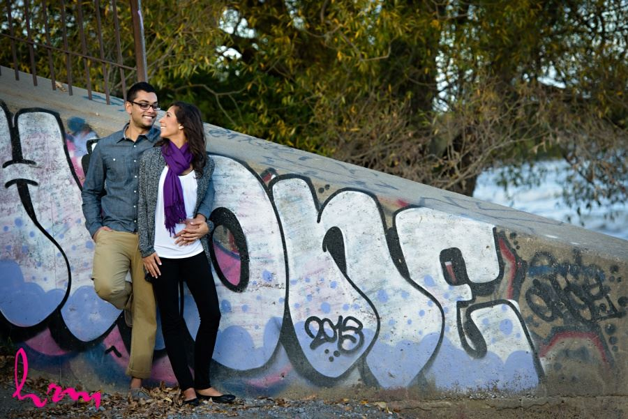 engagement session in front of graffiti wall