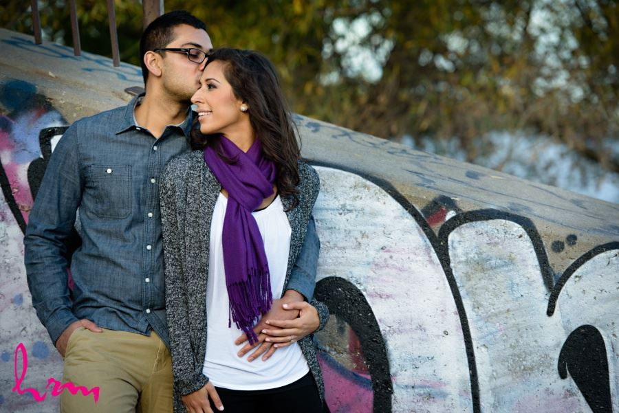 engagement session in front of graffiti wall urban