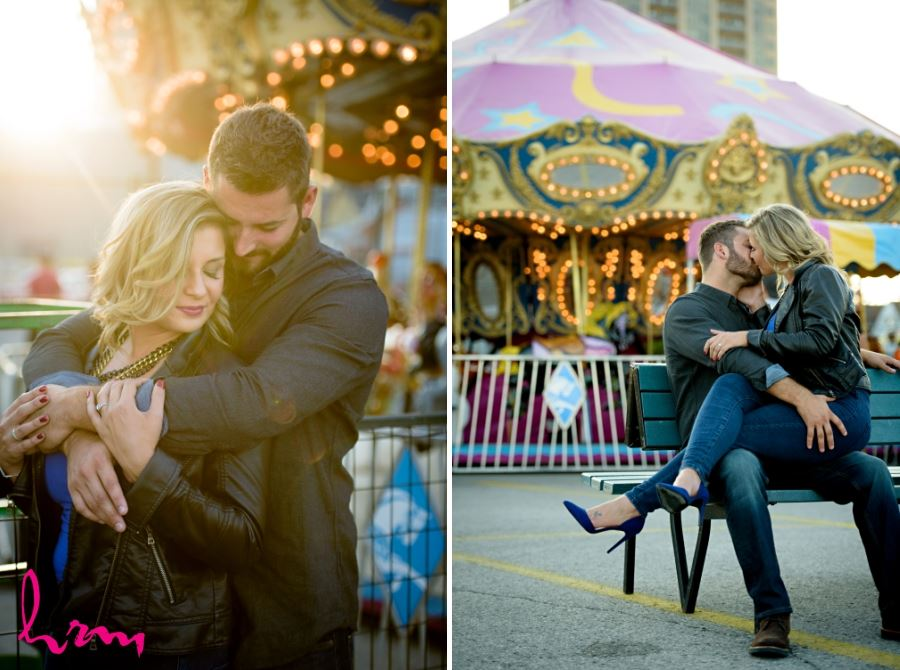 engagement session kissing in front of carousel at fall western fair