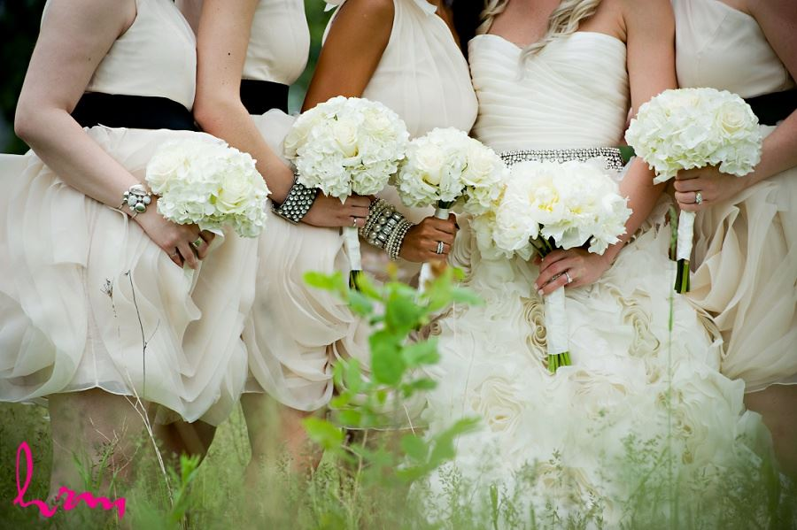 Wedding photo of bridesmaids holding bouquets