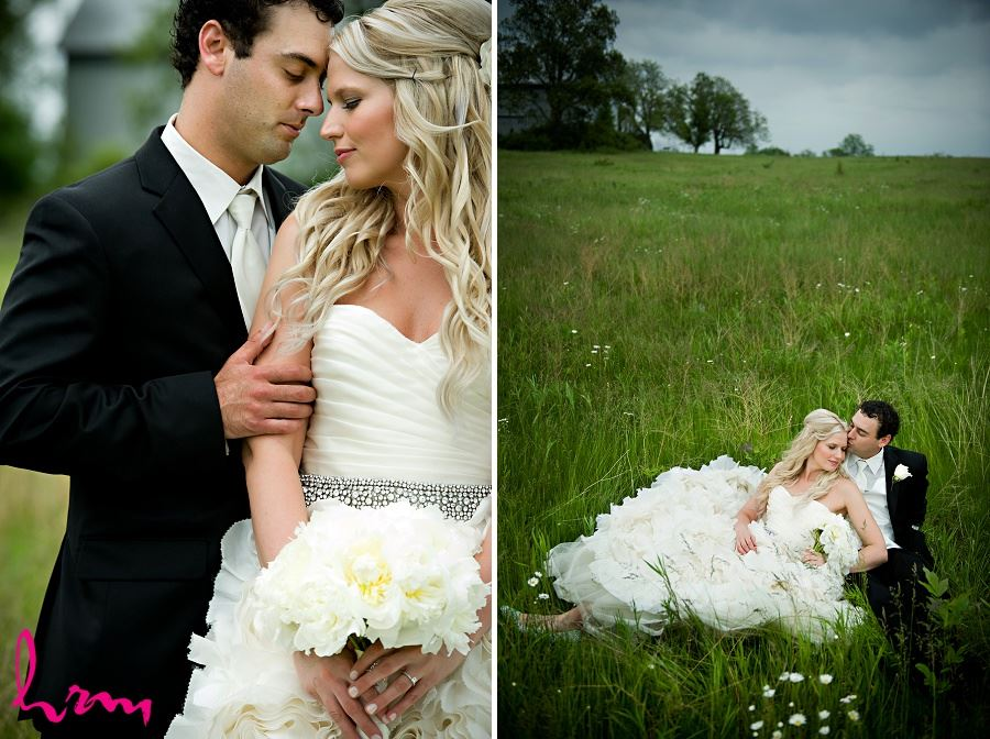Wedding photo of bride and groom embracing in field