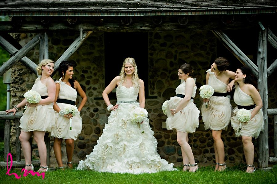 Wedding photo of bride and bridesmaids in rustic setting
