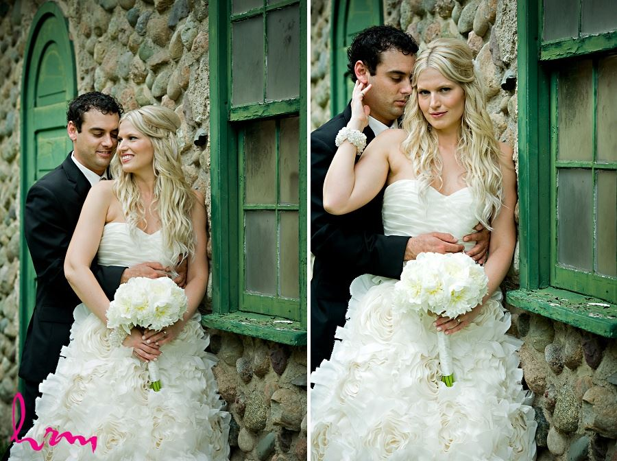 Wedding photograph of bride and groom in rustic setting