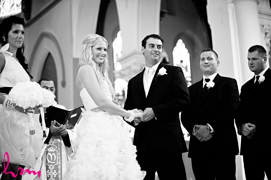 Black and white photo of bridal party at Altar taken by London Ontario wedding photographer