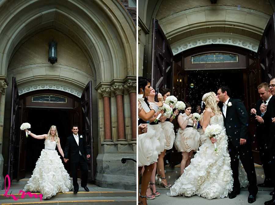 Celebrating outside church taken by London Ontario Wedding Photographer