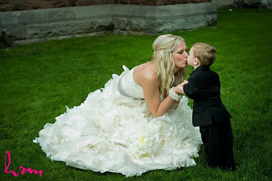 Photo of bride kissing little boy taken by London Ontario Wedding photographer
