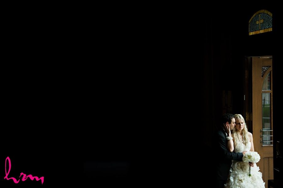 Photo of Ania and Ken in dark church taken by London Ontario wedding photographer
