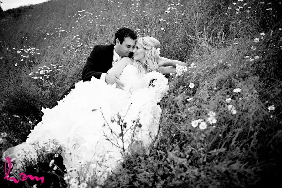 Black and white photo of Ken and Ania in grass taken by London Ontario wedding photographer