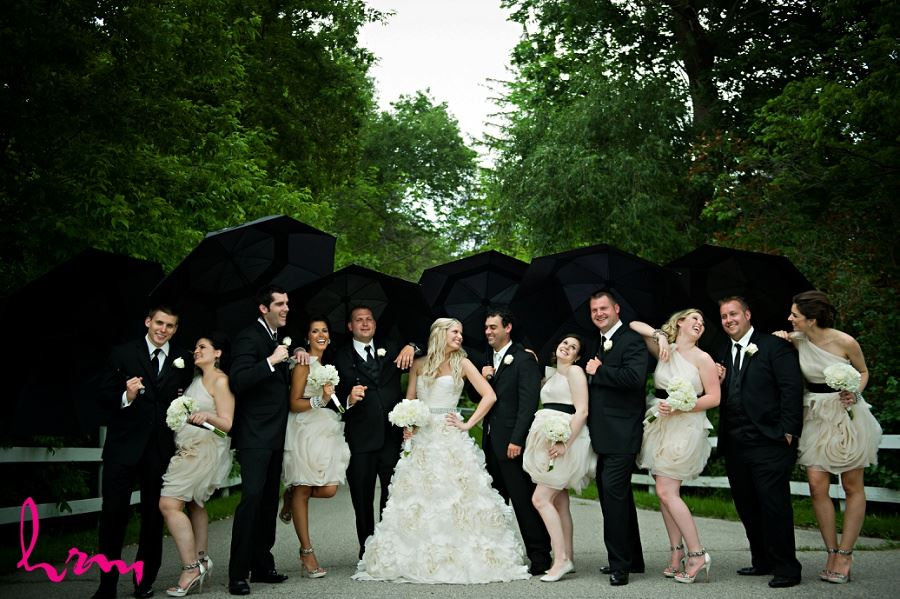 Bridal party with umbrellas taken by London Ontario wedding photographer