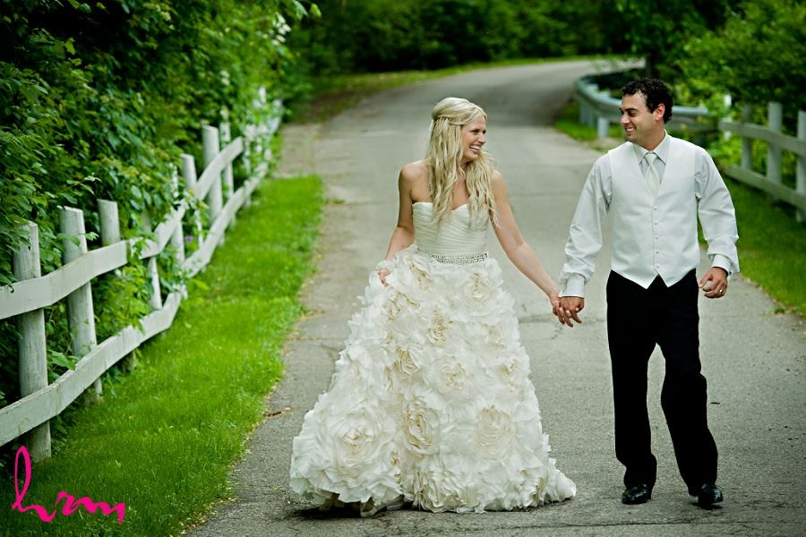 Wedding photo of bride and groom walking down road