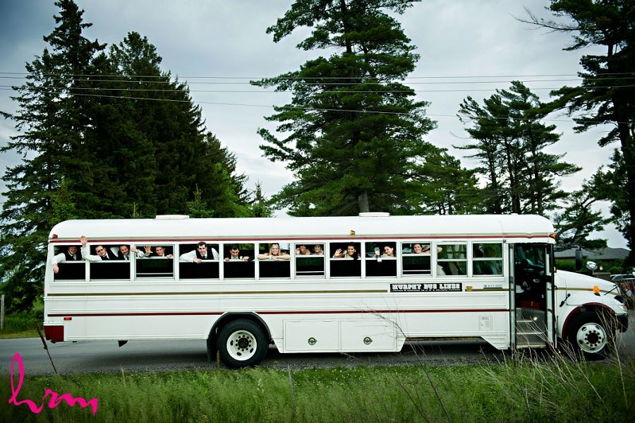 Wedding photo of bridal party on bus