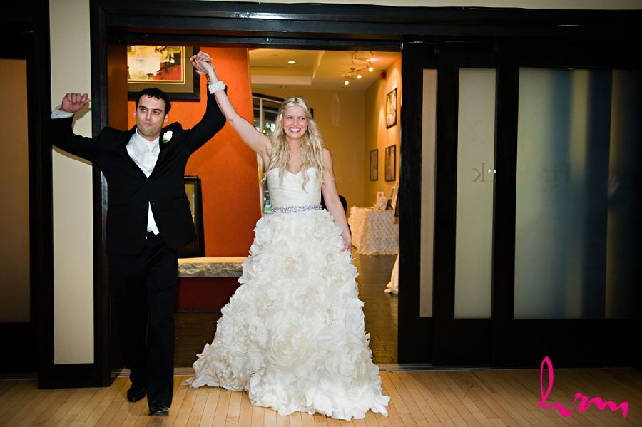 Wedidng photo of Ania and Ken entering reception