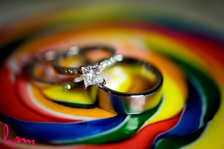 Wedding rings on candy background taken by London Ontario wedding photographer