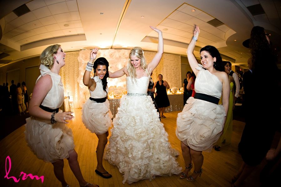 Bride and Bridesmaids dancing taken by London Ontario wedding photographer