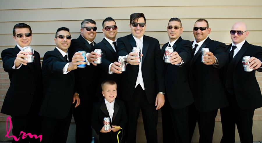 groomsmen with drinks and sunglasses