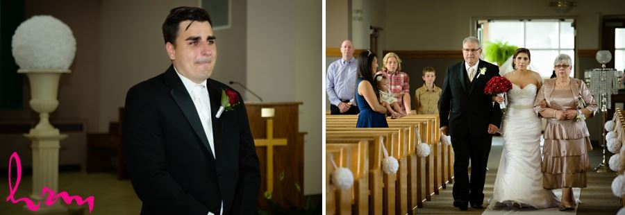 groom crying with bride walking down aisle