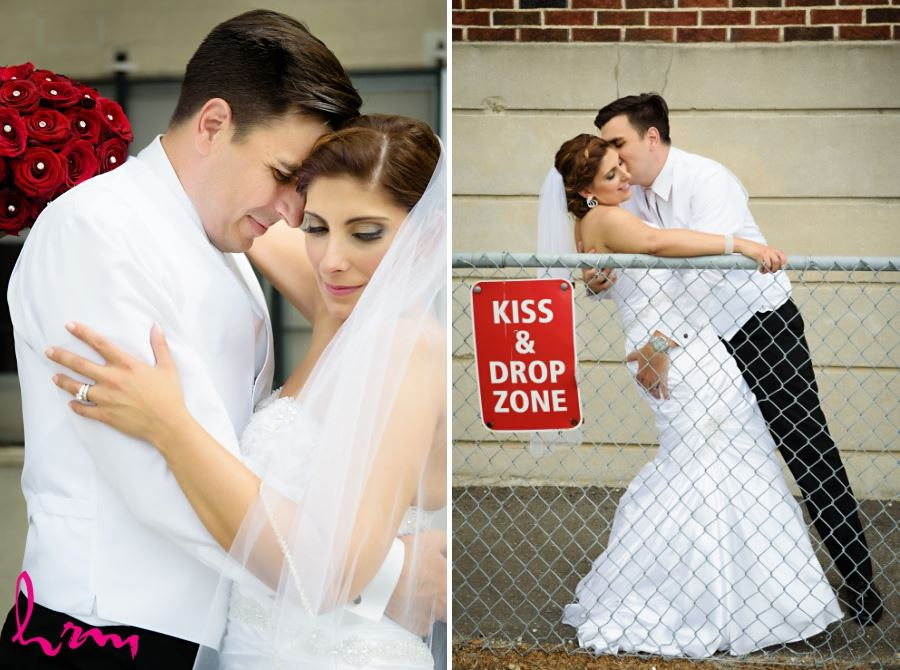 bride and groom with kiss & drop zone sign