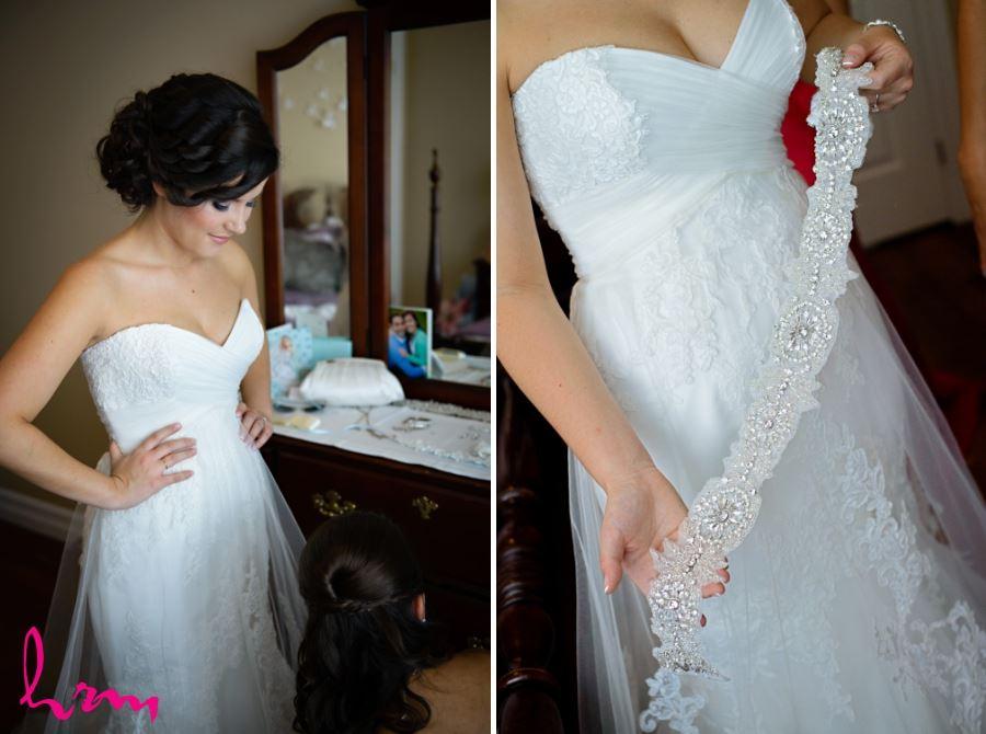 Ornate belt on lace wedding dress