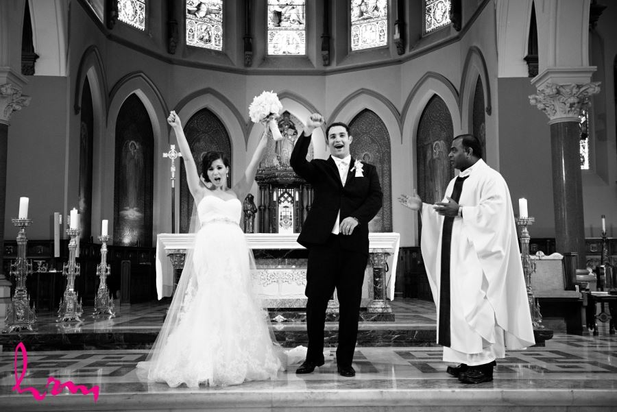 bride and groom pronounced husband and wife at alter