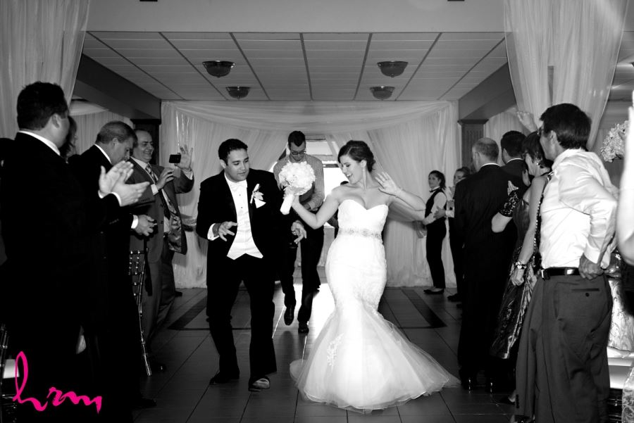 bride and groom entrance black and white