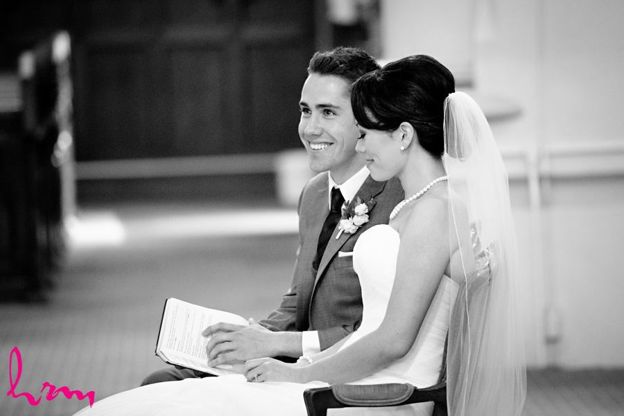 Black and white photo of Geneviève and Will in St. Peter's Cathedral London ON Wedding Photography
