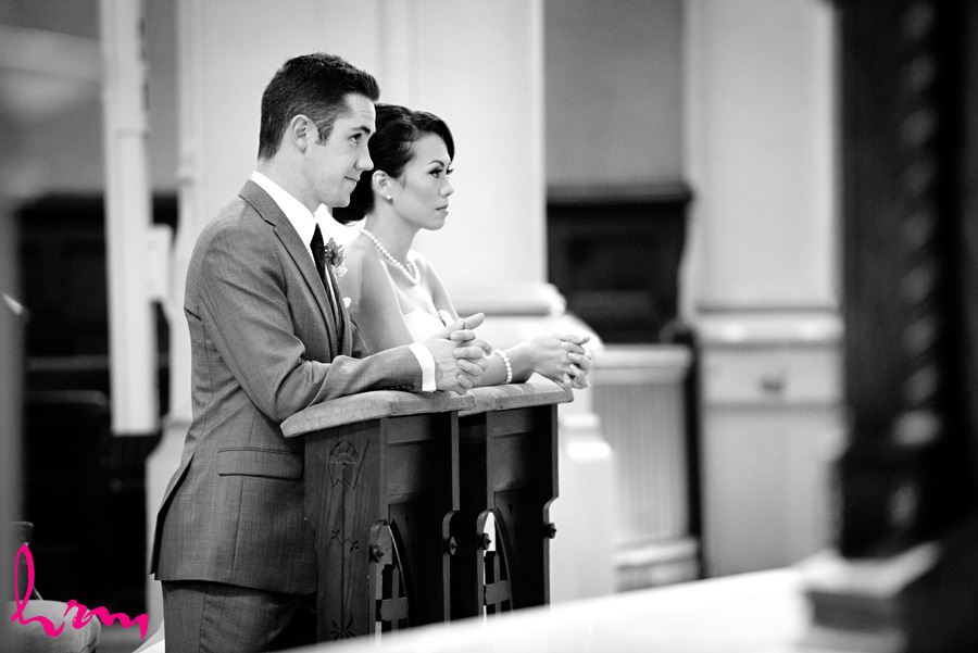 Black and white photo of the ceremony at St. Peter's Cathedral London ON Wedding Photography