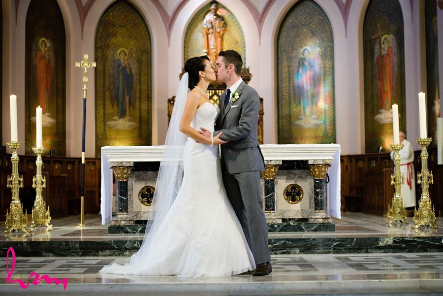 The kiss at St. Peter's Cathedral London ON Wedding Photography