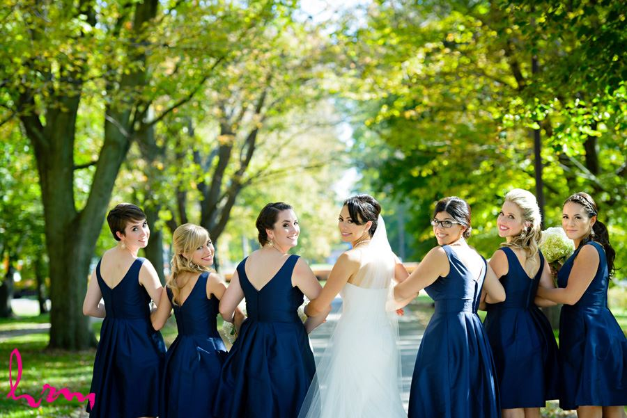 Geneviève and bridesmaids walking outside St. Peter's Cathedral London ON Wedding Photography