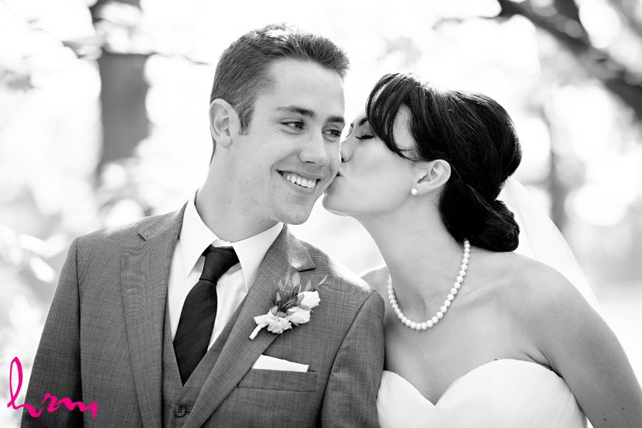 Black and white photo of Geneviève + Will outside St. Peter's Cathedral London ON Wedding Photography