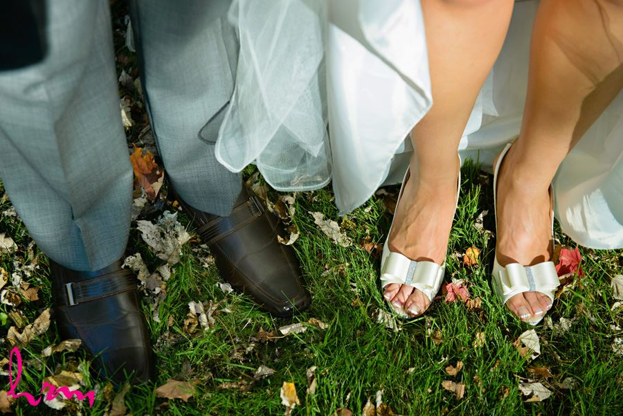 Geneviève and Will shoes in grass London ON Wedding HRM Photography