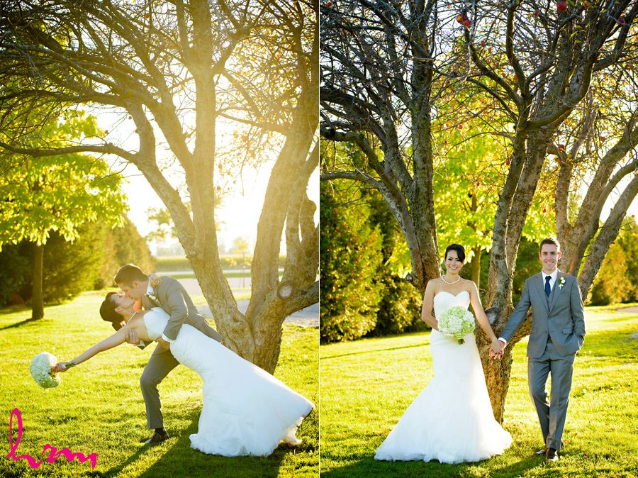 Geneviève + Will kiss in orchard Heeman Greenhouses London ON Wedding Photography