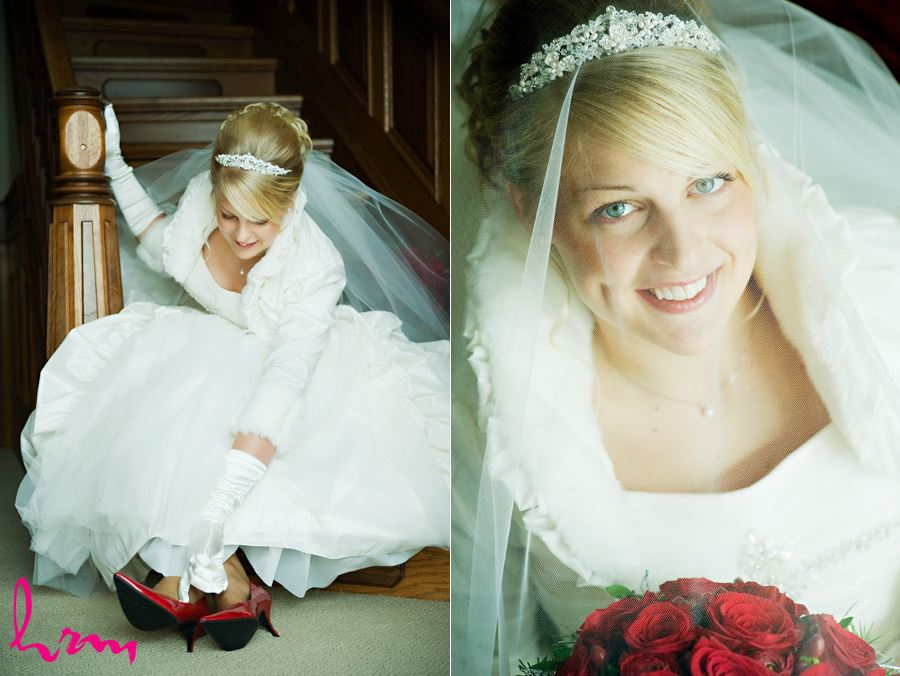 bride putting on her red shoes on staircase