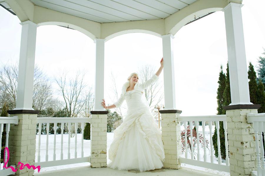 winter bride portrait outside in gazebo