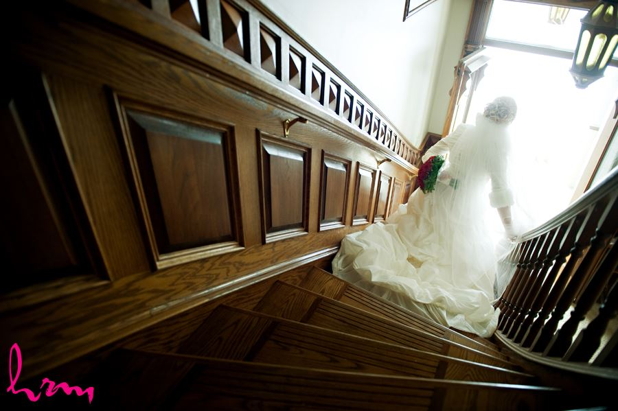 winter bride walking down the stairs at brides house