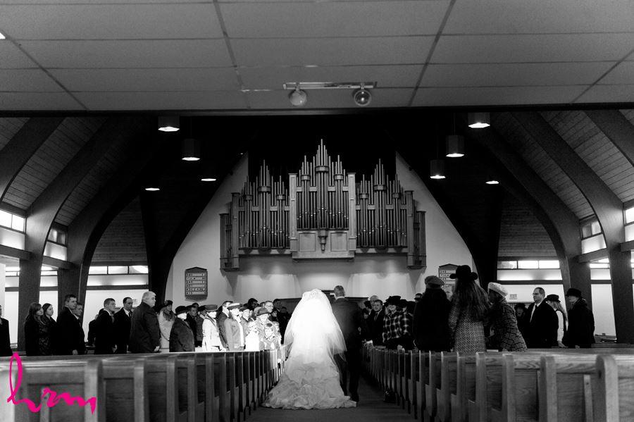 beam of light on bride walking down aisle in ingersoll ontario