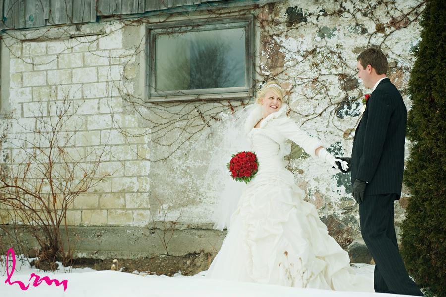 bride walking with groom holding hands in ingersoll ontario