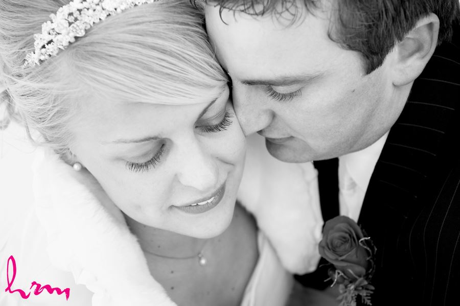 black and white close up of bride and groom outside in snow