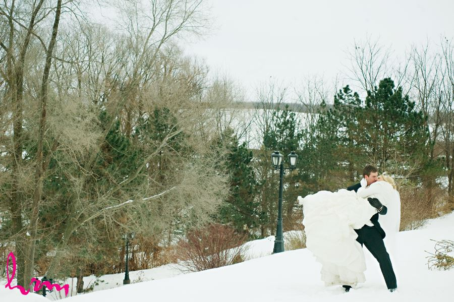 winter groom picking up bride and kissing