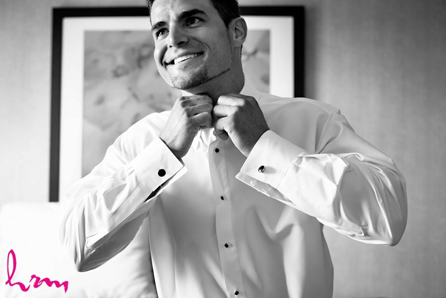 groom getting ready on wedding day in black and white