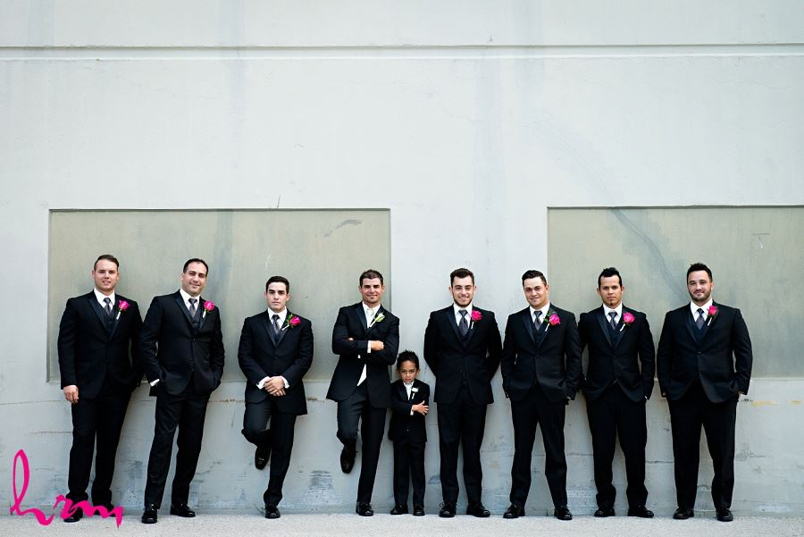 Groomsmen black suits and ties with pink boutineers