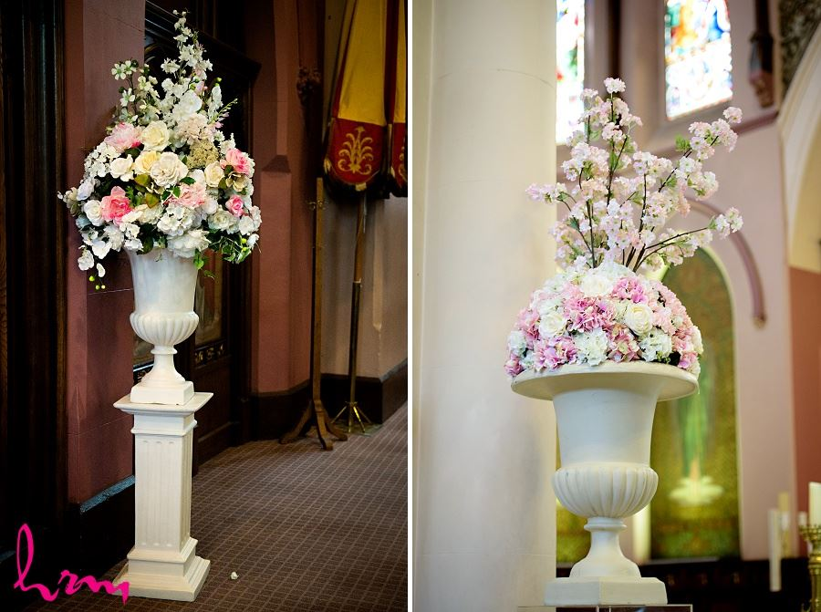 tall floral ceremony decor in urns