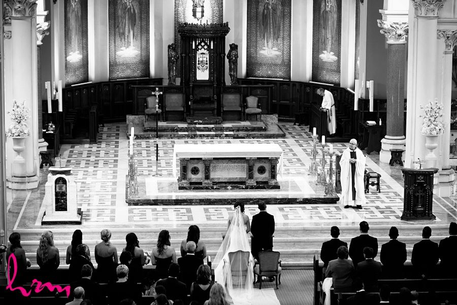 bride and groom at grand alter in london ontario wedding