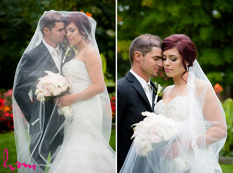 bride and groom under bride's veil