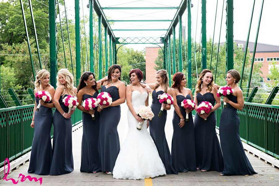 bridesmaids in dark gray charcoal with pink fuchsia bouquets