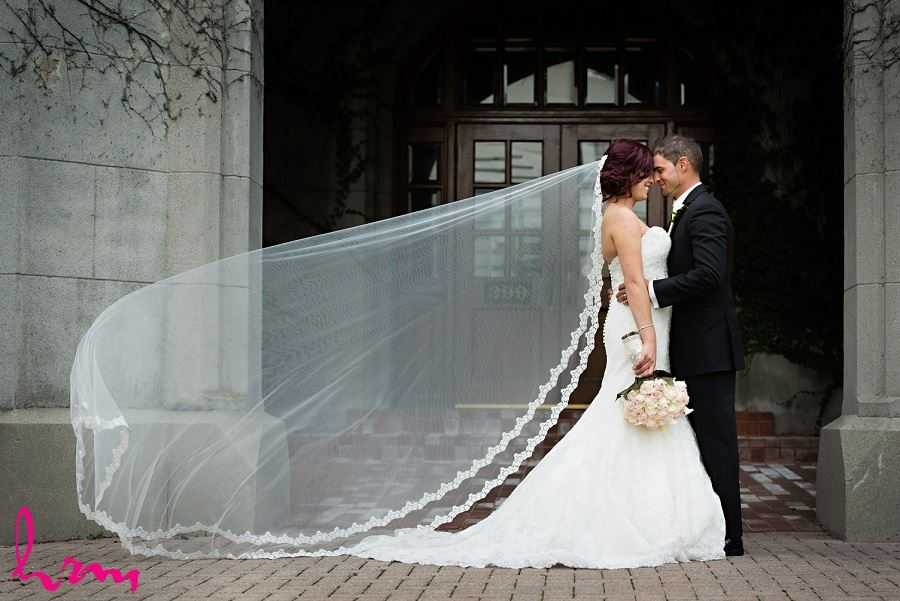 bride with long lace embellished wedding veil
