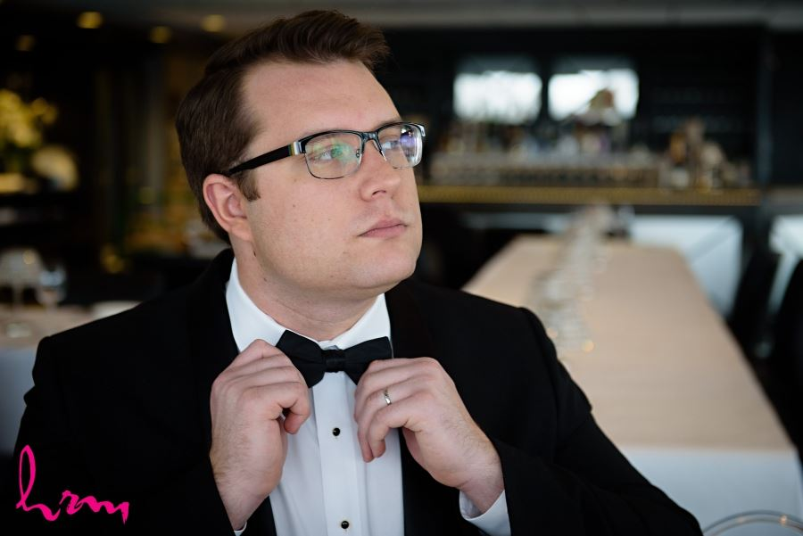 groom with bow tie and glasses