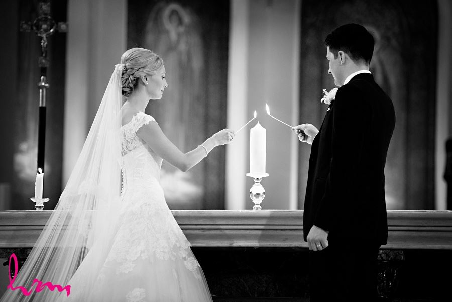Sabrina + Winston lighting candle in St Peter's Basilica London ON Wedding Photography