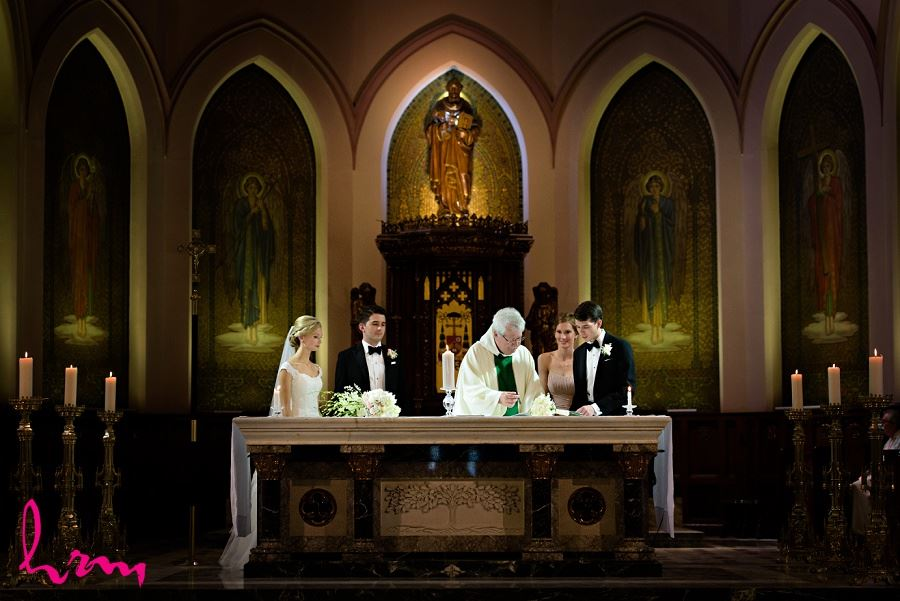 Sabrina + Winston signing registry in St Peter's Basilica London ON Wedding Photography