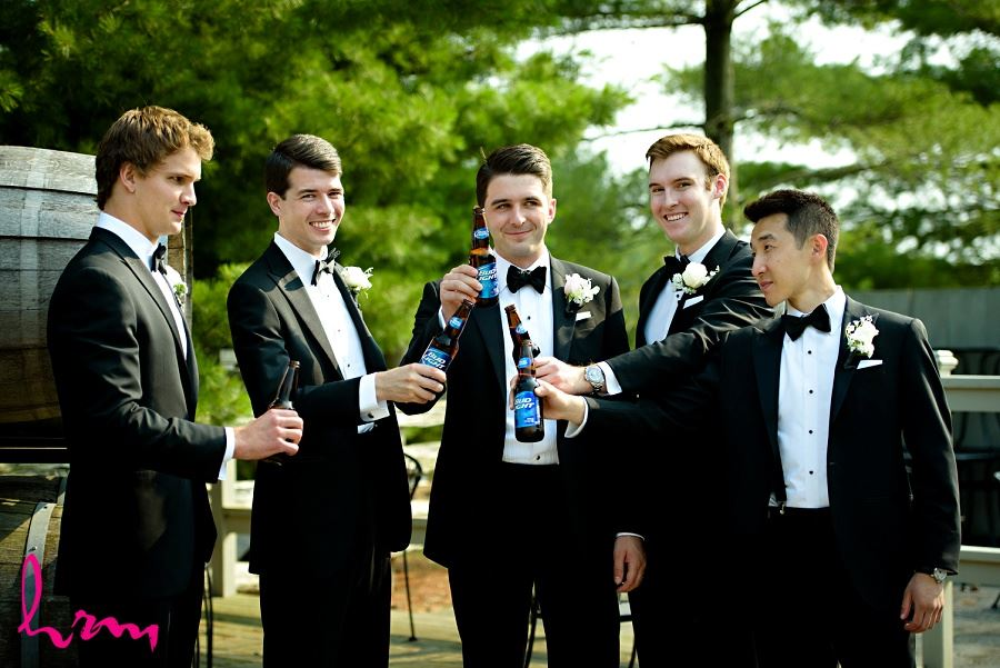 Groomsmen cheers at Bellamere Winery Event Centre London ON Wedding Photography